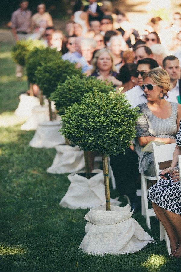 lined aisle - potted trees.  could move to the reception area after the ceremony - double decor