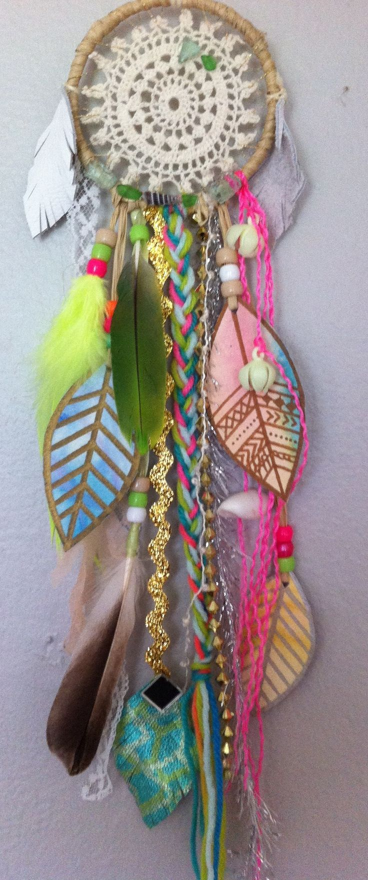 mini dreamcatcher by rachael rice with watercolor and natural parrot feathers