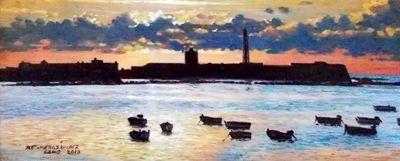 CADIZ-ATARDECER .atardecer en la playa de la Caleta de Cádiz, con el castillo de San Sebastián recortado sobre el horizonte. Autor: Francisco José Retamero Sanchez
