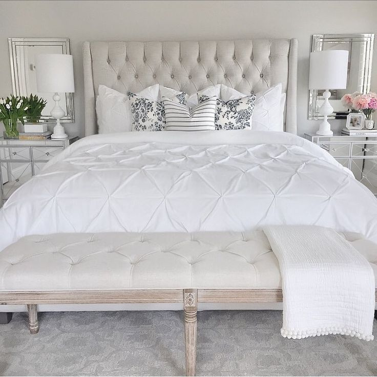 Bedroom inspo tufted linen bed gray paint mirrored nightstand white lamp gray Greek key rug, classic gray Benjamin Moore, floral pillows, white bedding, tufted linen bench, peonies   (@thedecordiet) on Instagram