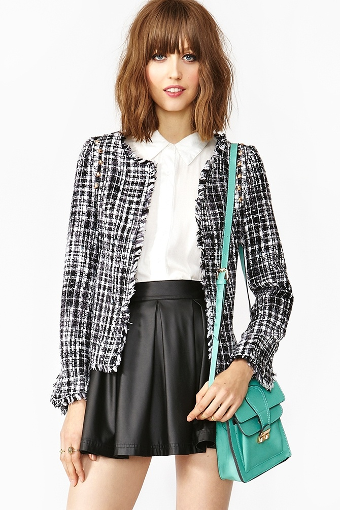 Everything! The tweed jacket, the teal purse and the pleather pleated skirt. Oh yes! And her haircut