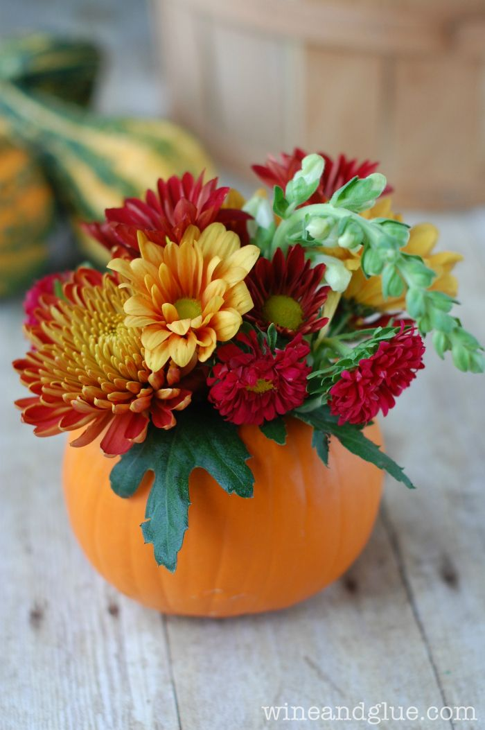 Because in our home, Halloween isn't a night about scary stuff, but a celebration of Fall and pumpkins! DIY Thanksgiving Centerpiece - wine & glue