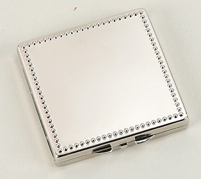 This high polish nickel plated square compact mirror features two mirrors inside - one standard and one magnified. The top of this purse mirror features a beaded frame - perfect for accenting the engraving! These make great gifts for your maid of honor, bridesmaids, or the mother of the bride or groom.