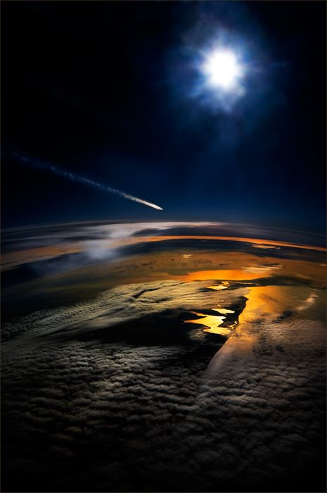 An aerial shot of a meteor shooting through the sky.
