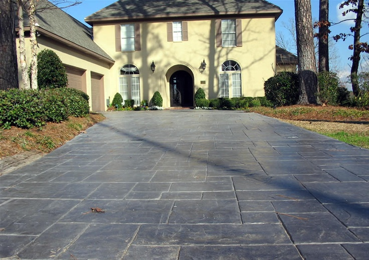 I love the look of stamped concrete for the driveway, patios and walkways...