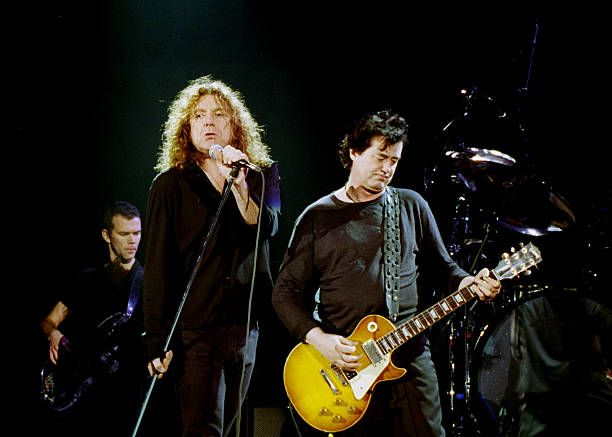 Photo of PAGE PLANT Jimmy Page Robert Plant frnher Led Zeppelin live in Concert in action Querformat