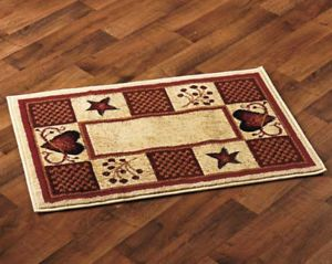 This primitive rustic scatter rug can be used inside the front door, at the kitchen sink or anywhere you need a small decorative rug. Works well with most decors.   The print is of hearts, stars and berries