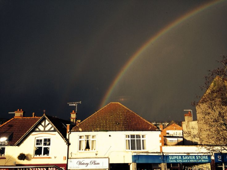 Beautiful rainbow in a dark sky. The sights you see when having coffee with a bestie.