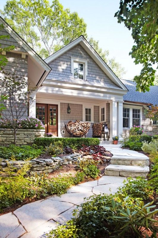 love the wood pile on the porch, the large gable that extends over to the porch