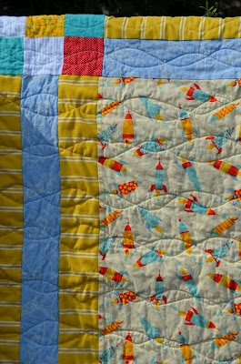cute baby quilt.  i like the machine quilting pattern --looks easy and cute