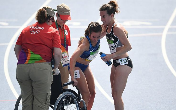 USA's Abbey D'agostino (2ndR) leaves the track on a wheelchair after competing in the Women's 5000m Round 1 during the athletics event at the Rio 2016 Olympic Games at the Olympic Stadium in Rio de Janeiro on August 16, 2016. / AFP / PEDRO UGARTE (Photo credit should read PEDRO UGARTE/AFP/Getty Images)