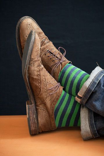 Wingtips and jeans with colorful socks. Love Love