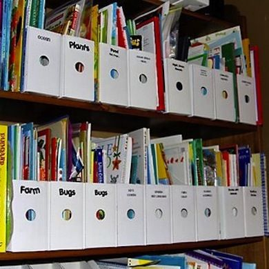 Use magazine holders to organize that jumble of books on the shelves of your playroom.
