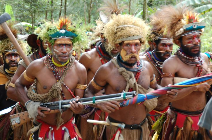 Southern Highlands Warriors coming to the compensation ceremony preparation. The two villages involved each had a young man murdered—so there was compensation being offered in both directions to the respective bereaved families in each village. The full warrior outfitting to me seemed to signify the seriousness of the occasion. Papua New Guinea.