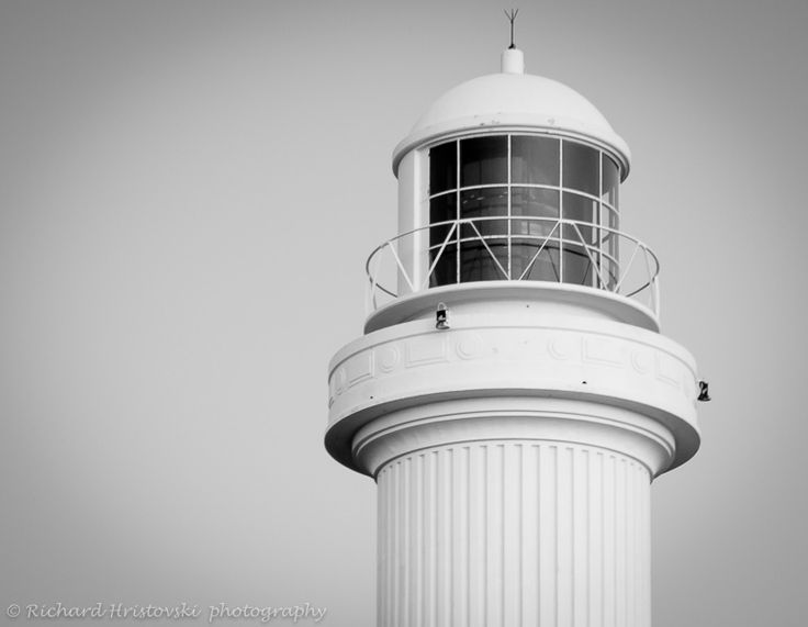 Re-Post L2M1AP3-Positive and negative space 1/10 sec at f/5.0,ISO 400 35mm exposure bias 1, metering pattern,white balance sun hand held from below in black and white, lighthouse placed on the third,edited in lightroom
