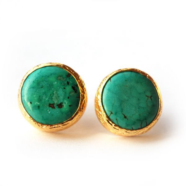 The Turquoise Stud Earrings by Toosis are crafted with a simple design, enabling the beautiful and unique Turquoise stones to stand out. This natural stone element gives each earring a slightly different colour and texture, and each earring is hand-crafted using gold-plated sterling silver.