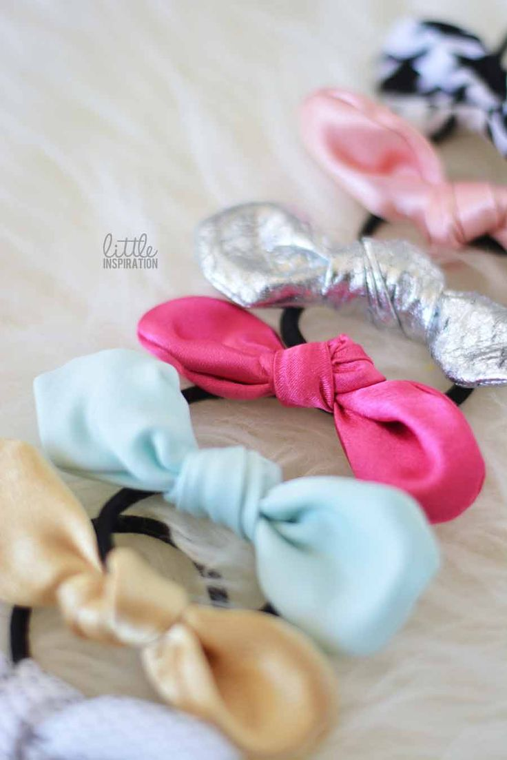DIY Knot Bows » Little Inspiration...I made a ton of these. These are cute for little girls and big girls alike...I have one in my hair as we speak!! So adorable, and a quick and easy way to use up those pesky scraps of material that I so hate to throw away. And it totally dresses up the messy bun.