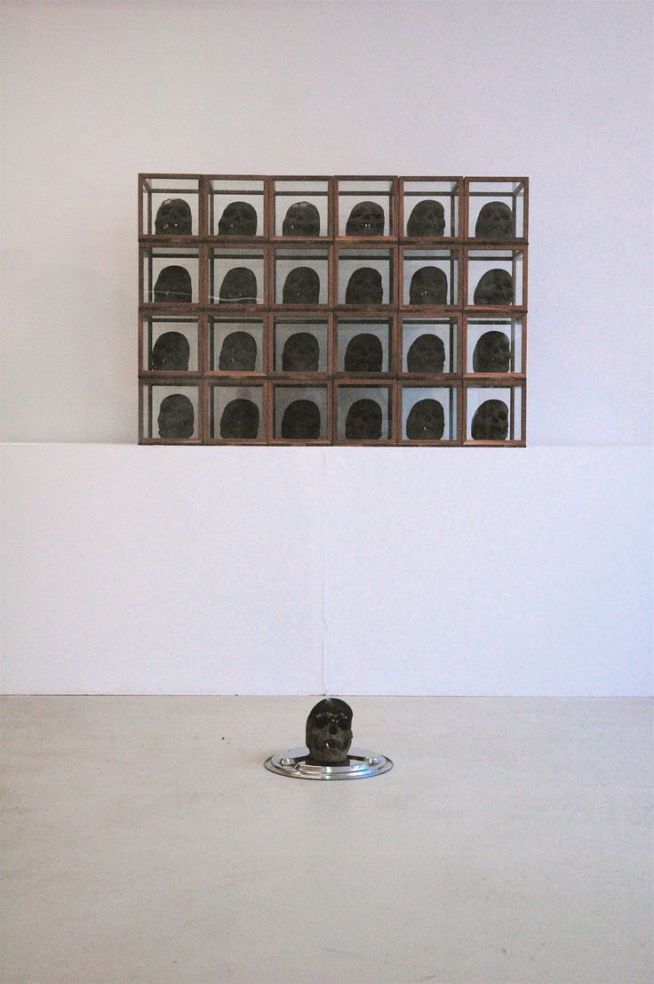 Incense Skulls installation with wood glass boxes