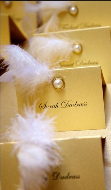 Gorgeous escort cards. Perfect for a masquerade theme wedding when using gold and champagne as part of your color scheme.