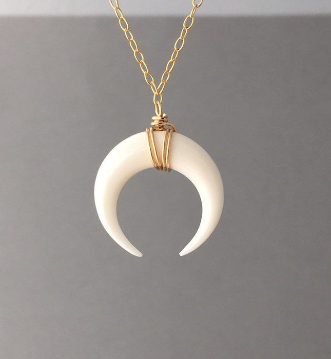 Love the look of this subtle gold wrap small white half moon double horn pendant necklace.