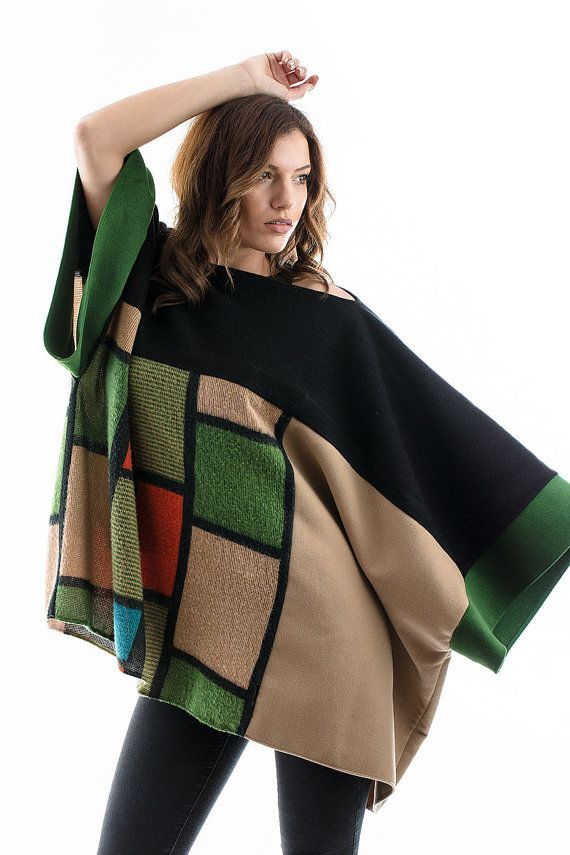 A very impressive patchwork style poncho, with a beautiful combination of colors. Combining black and checked knitted fabric, with beige and green