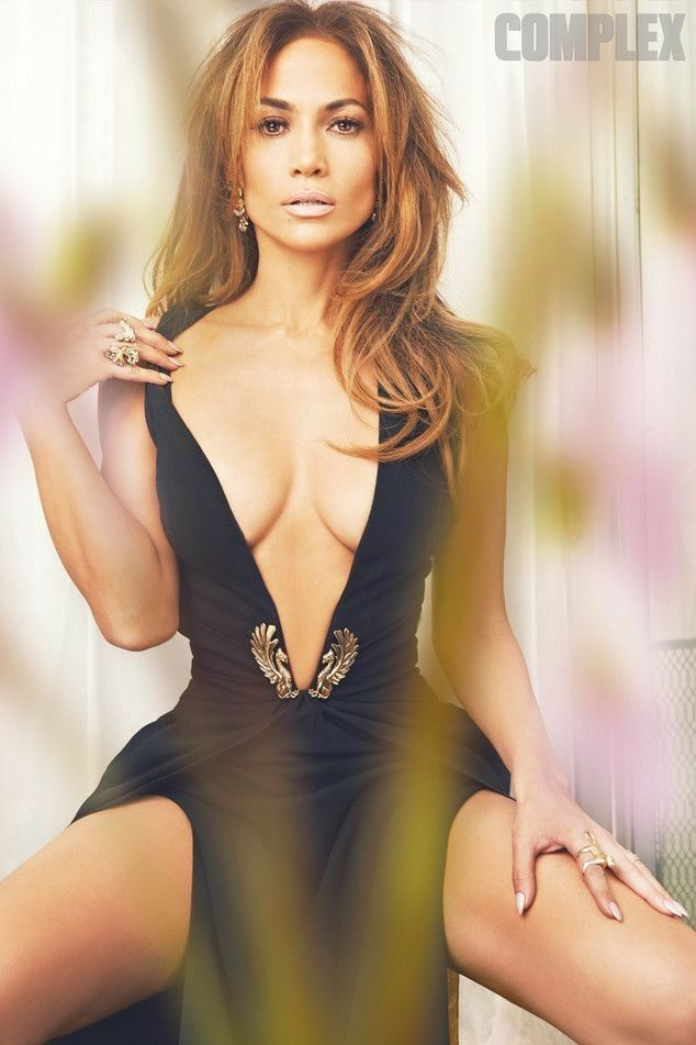 a61a0e69c5b Jennifer Lopez busty in plunging dress and sexy cleavage.
