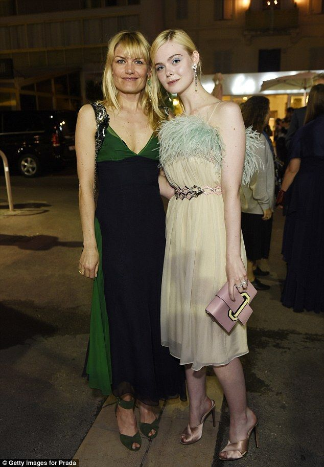 Blondes unite! Danish actress and filmmaker Liv Corfixen also posed alongside Elle, dressed in an Emerald green and black Empire line dress