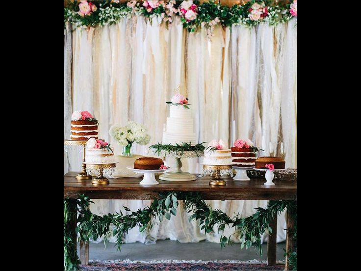 Vintage Ribbon Backdrop for a special cake table with eucalyptus greenery draping under a farmhouse table..  @ Flowers by Tammy