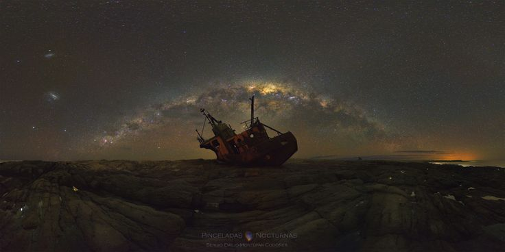 Milky Way over Shipwreck  What happened to this ship? It was carried aground by a giant storm that struck the coast of Argentina in 2002. The pictured abandoned boat, dubbed Naufragio del Chubasco, wrecked near the nearly abandoned town of Cabo Raso (population: 1). The rusting ship provides a picturesque but perhaps creepy foreground for the beautiful sky above. This sky is crowned by the grand arch of our Milky Way and features galaxies including the Large and Small Magellanic Clouds…
