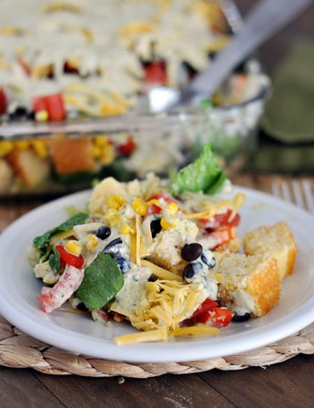 Layered Mexican Cornbread Salad  My family LOVED this and can't wait for me to make it again! I used black beans, bottled ranch dressing and also did not add the bacon. It was GREAT!
