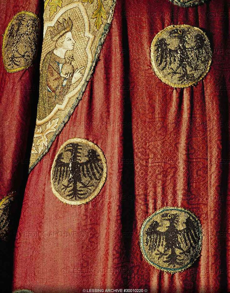 MEDIEVAL TEXTILES:ALL 13TH CENTURY   Eagles with enamel eyes and image of a prince, from the Eagle Dalamatica worn for the coronation by Emperors of the Holy Roman Empire. Chinese damask with purple silk embroidery. Around 1300.  Kunsthistorisches Museum, Schatzkammer, Vienna, Austria