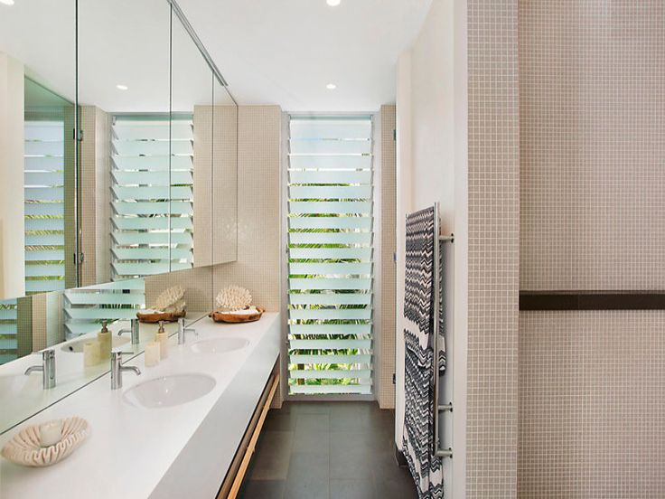 Privacy louvre windows adds light to a narrow bathroom. #windows #louvre #bathrooms