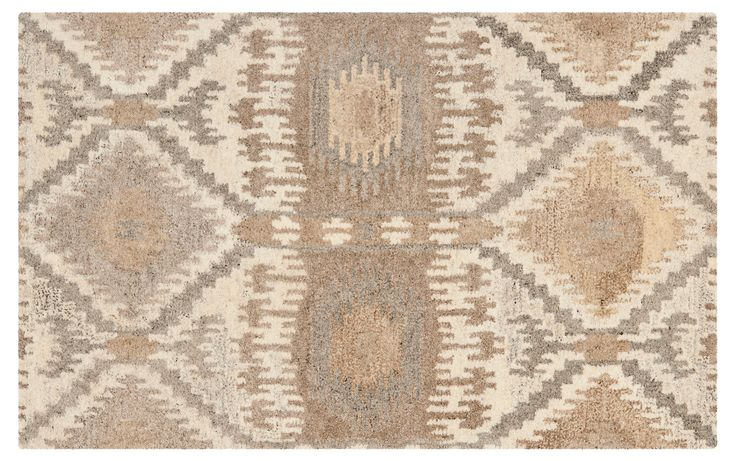 In soft, neutral hues and featuring a subtle Southwestern design, this hand-tufted wool rug adds a touch of warmth to your room. A rug pad is recommended to keep this securely in place.