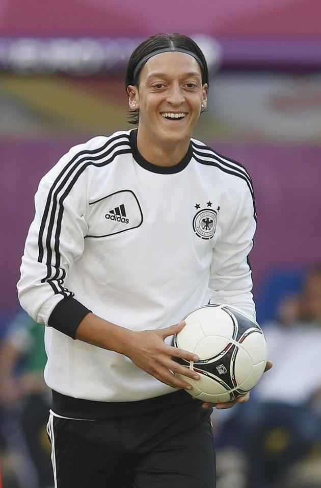 Mesut ozil displaying the football.he ranked first in assists in La Liga with 17.[3][4] He was also one of the top assist providers in the 2010 FIFA World Cup and UEFA Euro 2012 with 3 in both. 630×956 http://nirhara.com/mesut-ozil-hd-desktop-wallpaper-gallery-2/