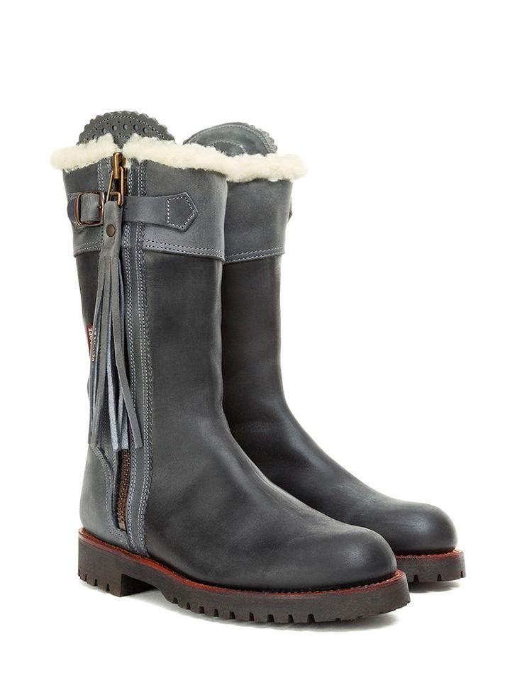 The original Penelope Chilvers Midcalf Tassel Boot in Spanish leather (vegetable dyed cowhide). This handmade boot has a scalloped detail at the zip panel and a leather tassle on the zip pull. It is fully lined with luxurious fleece with a Goodyear Welted Commando rubber sole.  (CALF MEASUREMENTS, circumference measurment for each size at widest in inch: 35=12, 35.5=12.5, 36=12.5, 36.5=12.5, 37=12.5, 37.5=12.5, 38=12.5, 38.5=12.5, 39=13, 39.5=13, 39.5=13, 40=13, 40.5=13, 41=13, 41.5=13…