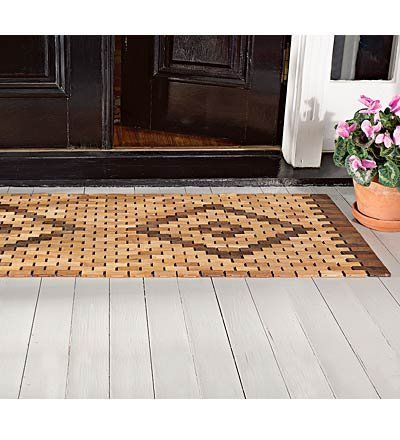 """Easy-Care 19 inches x 34 inches Reversible Solid Teak Door Mat with Oiled Finish for Outdoors . $49.95. Rolls up for compact storage. Easy to clean with garden hose. Teak door mat. Reversible tiled diamond pattern. Solid teak tiles in two shades are """"woven"""" into a diamond pattern that makes a striking impression at your entryway - so much more attractive than rubber or poly! Our 19"""" x 34"""" Reversible Solid Teak Door Mat is easy to care for and its oiled finish weathe..."""