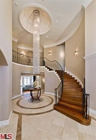 Entryway.  The dramatic, two-story entryway sets a posh tone for the entire home with a sweeping staircase and a glittering chandelier.
