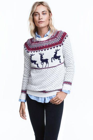 Jacquardgebreide trui: Een jacquardgebreide trui van katoenmix met alpacawol. De trui heeft lange raglanmouwen en een ribgebreide boord aan de onderkant en onder aan de mouwen.