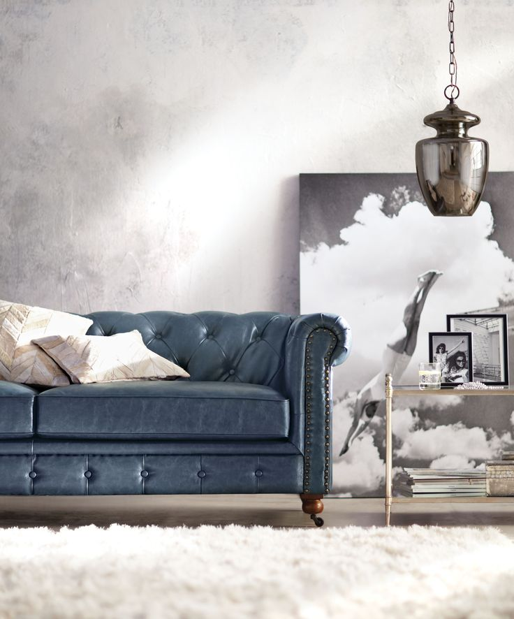 Got to love a blue leather sofa. Pair it with a soft white rug and you're set. HomeDecorators.com #blueandwhite