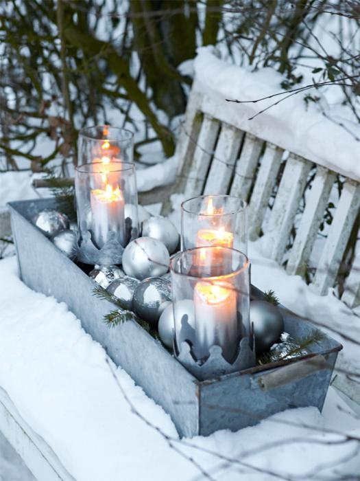 Tin box full of silver ball Christmas ornaments, sitting on a snowy bench!