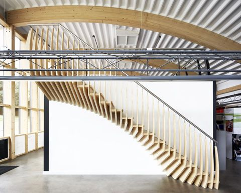Balusters extend out of the 'layers'. Made from bamboo it is an eco-friendly staircase called MindStep by EeStairs.