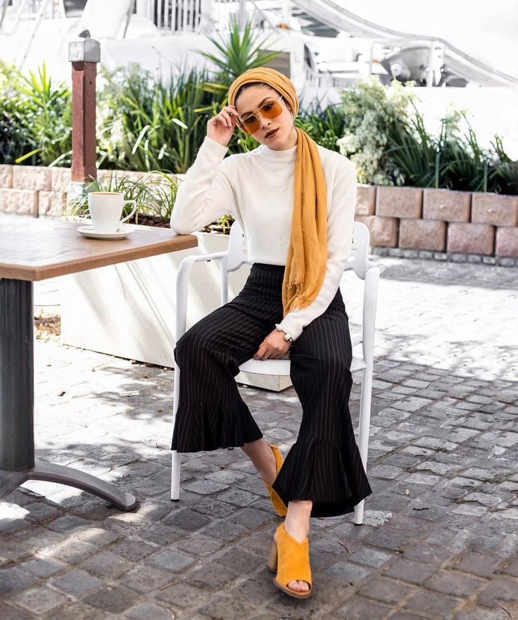 A bright day for coffee in Cape Town is perfect for Nabilah Kariem to wear her bold Gigi for Vogue Eyewear shades.
