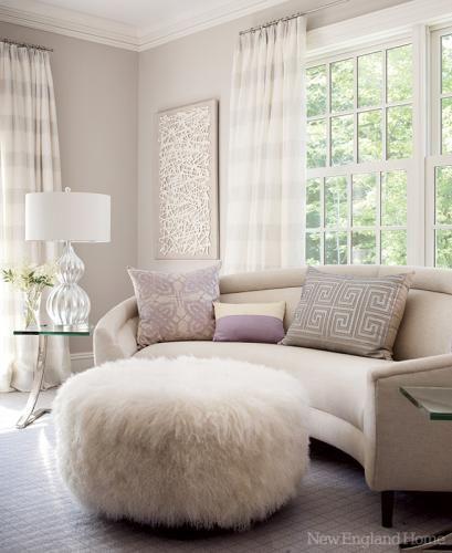 love the round ottoman + curve hugging sofa