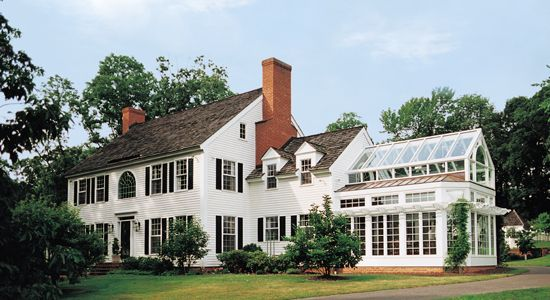 Colonial Home With Conservatory Featuring Standing Seam