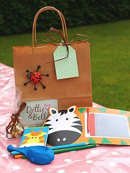 Make fun bags full of activity books and ideas to keep kids entertained for the day.