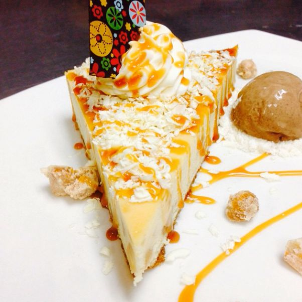 White Chocolate Macadamia Nut Cheesecake with Candied Macadamia Nuts and Chocolate Gelato