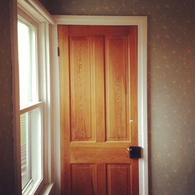 Digging the light wood with white trim compromise for Wood doors with white trim pictures