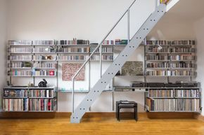 """7"""" and 12"""" vinyl together with CDs; flipped shelves and a double shelf accommodate the hifi separates. Our meticulous free planning service allows this to happen"""