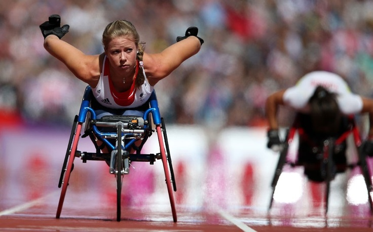 Hannah Cockroft of Great Britain competes in the Women's 100m - T34 in the Olympic Stadium