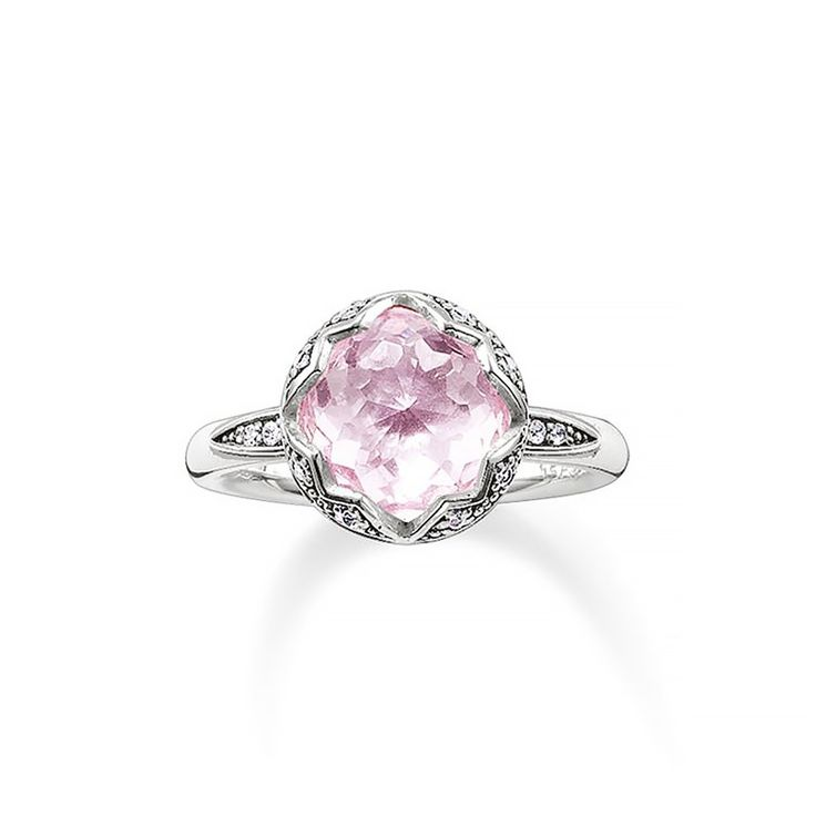 Like morning dew, the white zirconia on the flower-shaped setting of the THE PURITY OF LOTOS ring sparkles, bringing a distinguished dazzle to the pink synthetic corundum in the lens cut especially developed for THOMAS SABO.